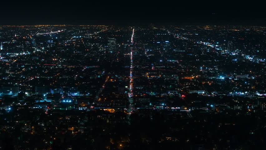 Beautiful view of Los Angeles from Griffith Observatory. Shinning city lights and traffic. California. Timelapse. Zoom in. | Shutterstock HD Video #32946595