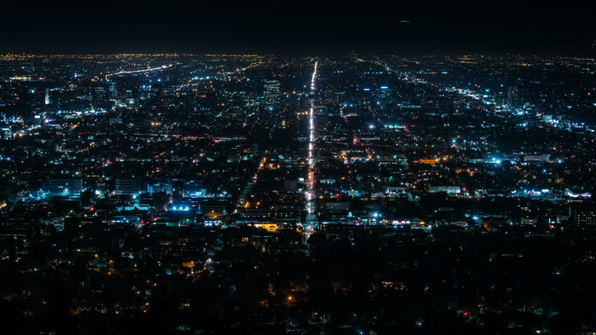 Beautiful view of Los Angeles from Griffith Observatory. Shinning city lights and traffic. California. Timelapse. Loopable.