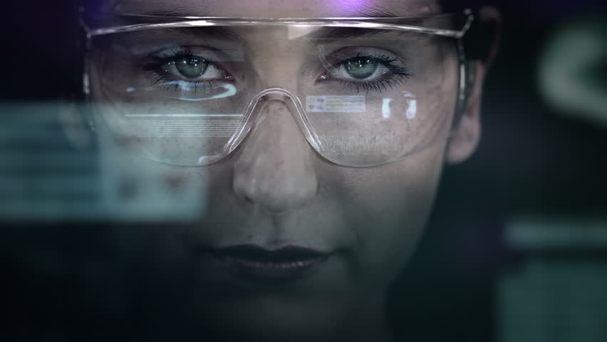 Young woman with holographic glasses. Medical. Augmented reality. Dark.