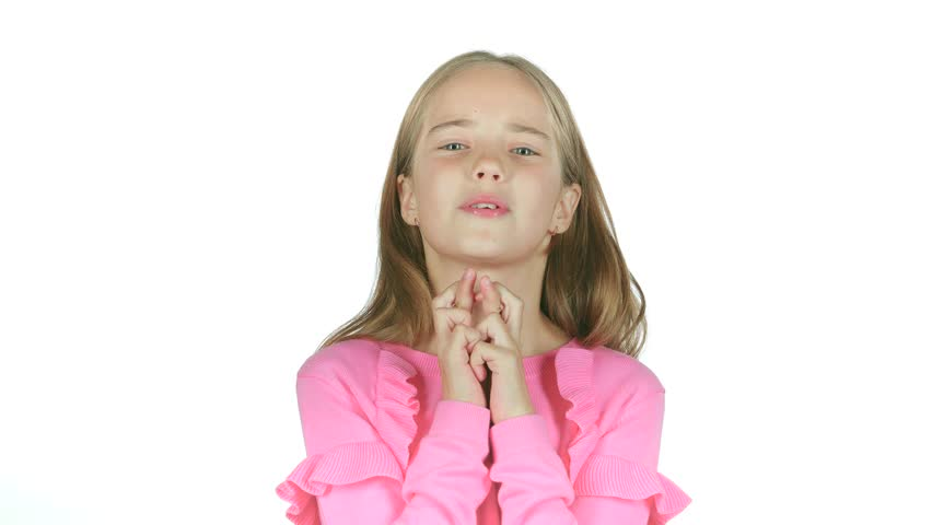 Child crosses his fingers, she hopes to win. White background. Slow motion | Shutterstock HD Video #32957821