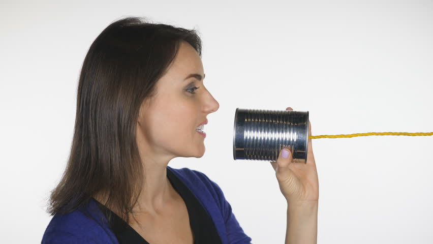 Attractive woman talks into tin can. Profile shot. Obsolete telephone communication.  | Shutterstock HD Video #32958079