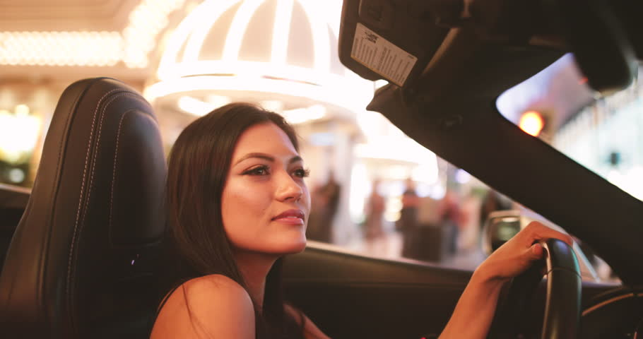 Exited female in convertible driving through downtown Las Vegas | Shutterstock HD Video #32968612