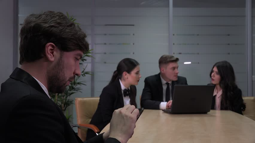 Executive business people meeting man with cell phone in the office team working | Shutterstock HD Video #32978572