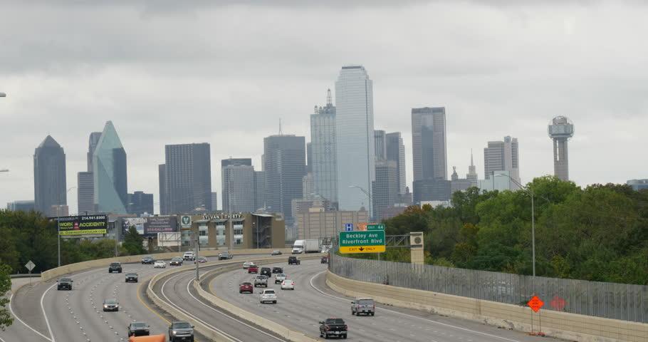 Dallas Texas - October 2017 : Dallas Texas City on Stormy Day Establishing Car Traffic 10bit
