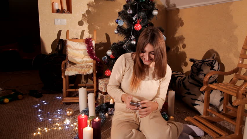In the festive New Year's environment, the girl uses a mobile phone | Shutterstock HD Video #32991475