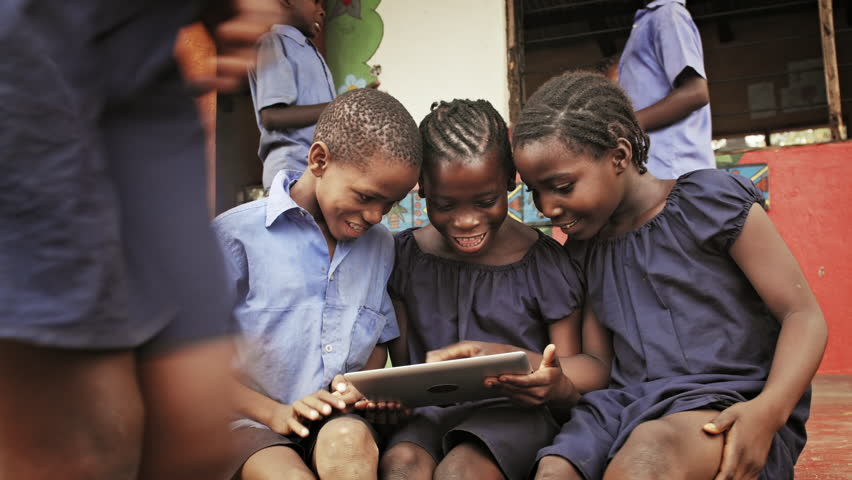 4k of African school students / pupils using tablet computer during lunch break at school. #33005878