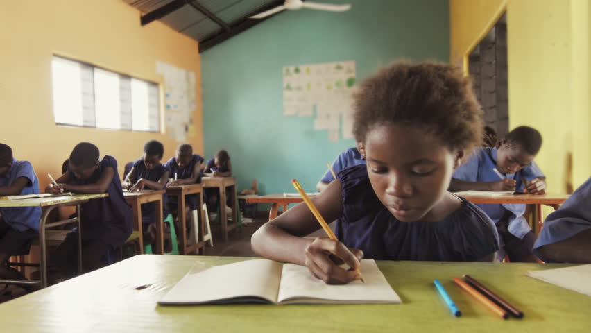 4k close view of pupils in classroom of African children writing English in school notebooks. #33009778