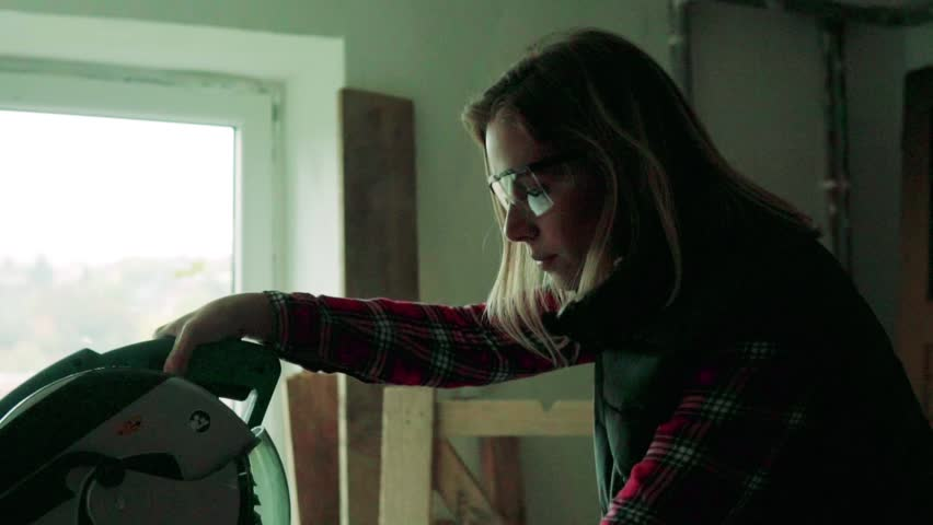 Young woman worker in the carpenter workroom. | Shutterstock HD Video #33023326