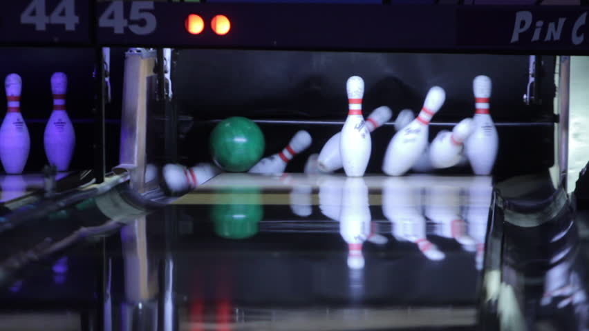 TAMPA, FL - JUNE 4: Bowling game, ball knocking all pins over for successful strike on June 4, 2017.
