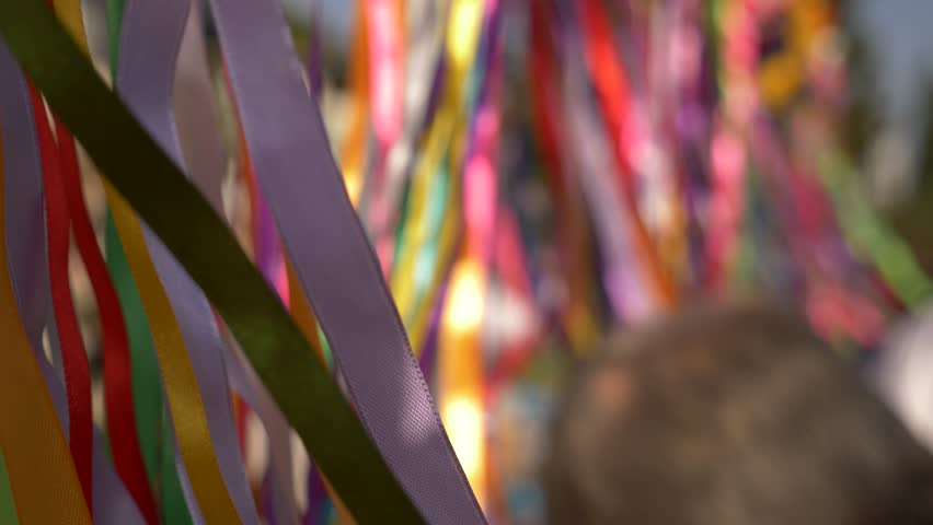 Close-up of the wind flaps of a garland of colorful ribbons. Copy space 4k | Shutterstock HD Video #33038308