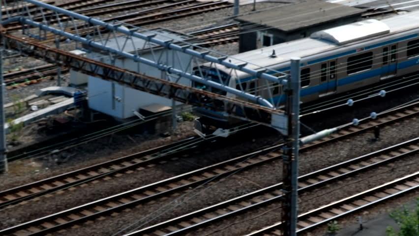 TOKYO, JAPAN - NOVEMBER 17TH, 2017. Japan Railway train moving on is track at Tokyo Station. Establishing shot. | Shutterstock HD Video #33040819