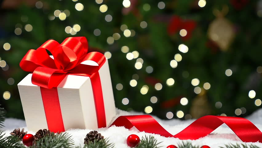 Christmas gift on snow, light background | Shutterstock HD Video #33058978