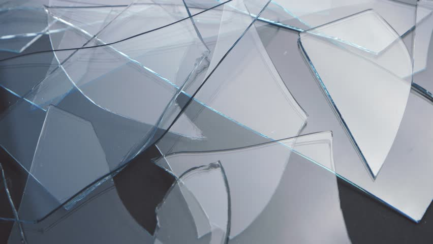 Shards of glass lie on the table. Close up | Shutterstock HD Video #33068740