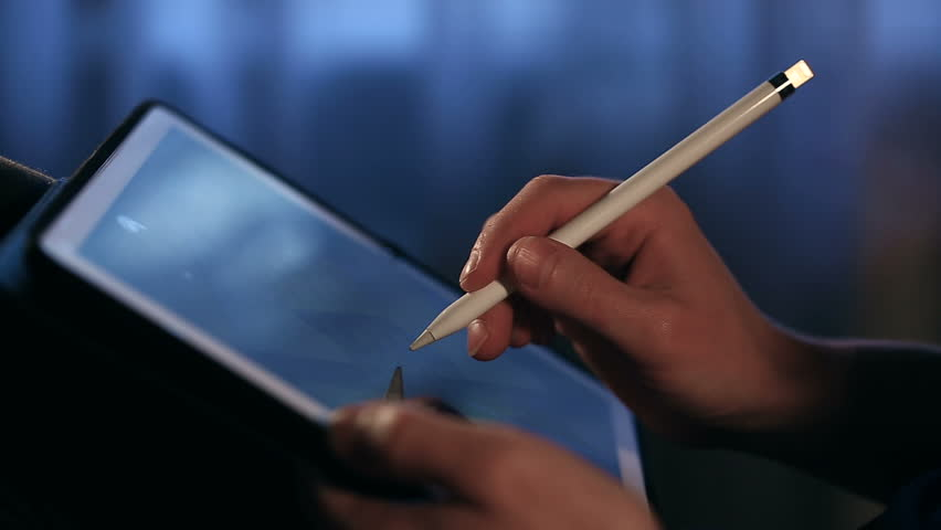 Closeup shot of designer's hand drawing a picture using tablet with stylus at home.  | Shutterstock HD Video #33082786