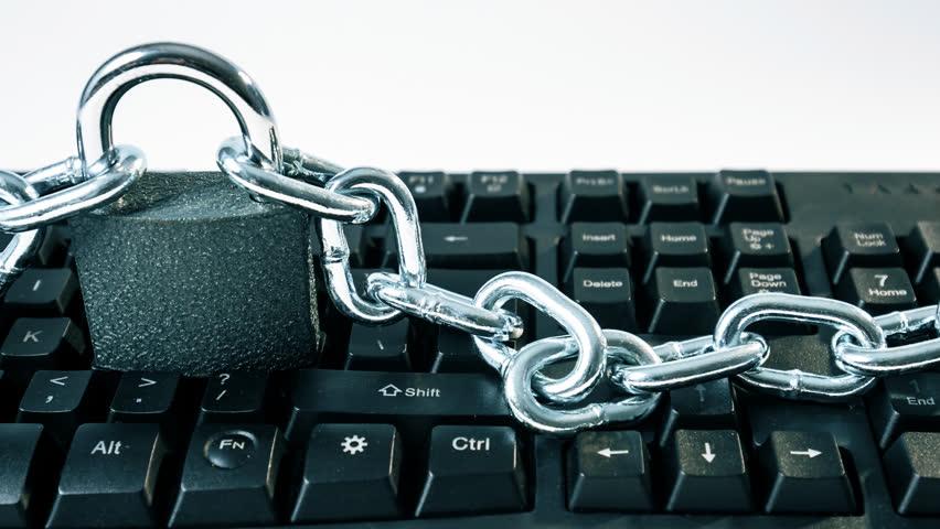 Computer keyboard chained, cybersecurity metaphor 4k   Shutterstock HD Video #33096424