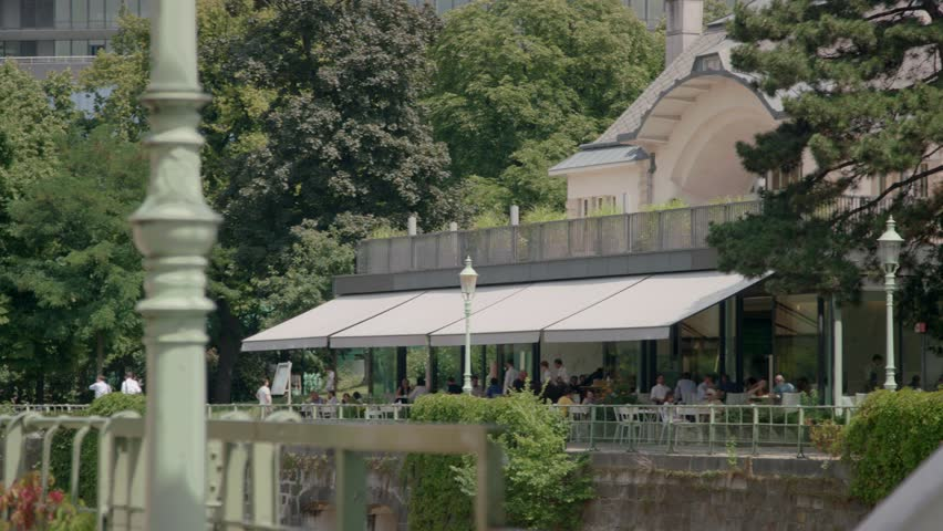 Camera pans from the beautifully path next to the Wienfluss in the Stadtpark to a famous Restaurant, called Meierei. | Shutterstock HD Video #33098122