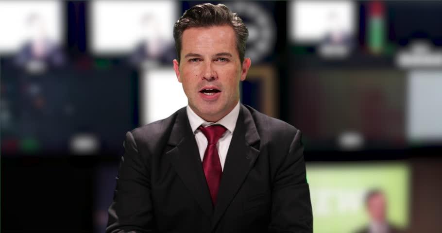 News presenter reading breaking news