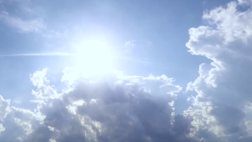 Sunrise clouds in blue skies. Beautiful rainy mass with large, building white and sunset breaking through. Time lapse of bright sun shining with passing. FHD. 1080p