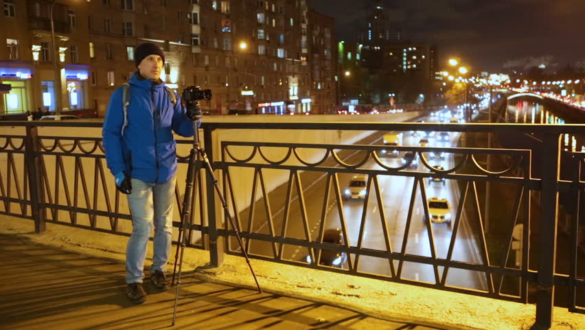 The photographer shoots the night city. | Shutterstock HD Video #33159115