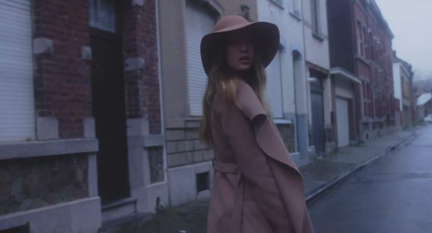 TRACKING SHOT Beautiful Caucasian female in stylish outfit walking in the streets of old European city, urban background. 4K UHD 60 FPS SLO MO | Shutterstock HD Video #33164179