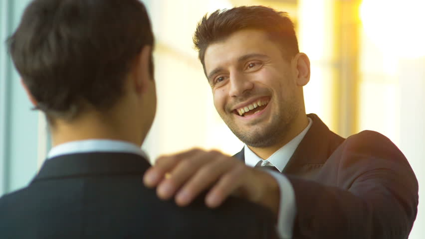 The businessmen pat on the shoulder on a sunny background. slow motion | Shutterstock HD Video #33182791
