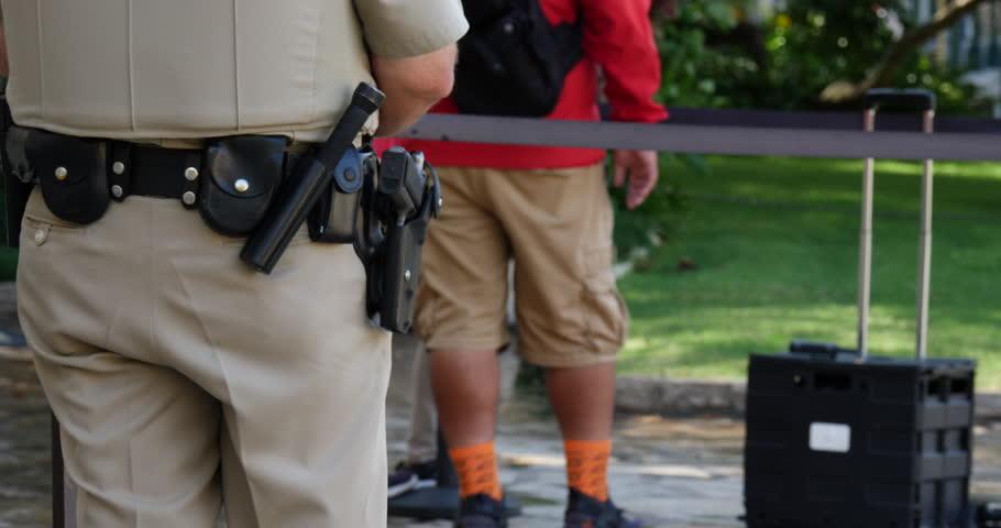 San Antonio Texas - October 2017 : Police Officer at The Alamo Mission in San Antonio Texas Close Up