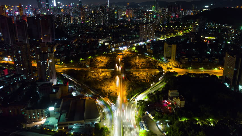 Nigh time shenzhen city traffic road junction aerial panorama 4k timelapse china