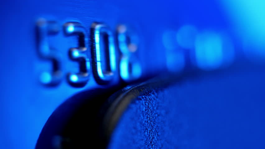 Payment by the credit card. Credit card extreme closeup. Shallow depth of field.