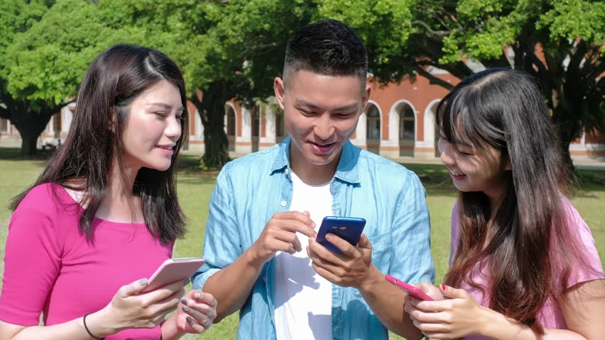 Happy student use and look each other phone in the school | Shutterstock HD Video #33200275