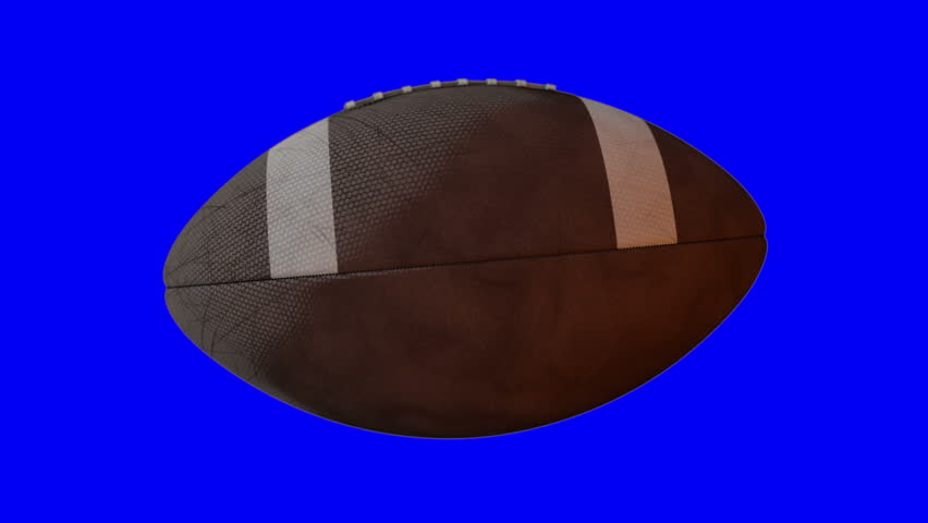 A loop able animation of an america football ball spinning in slow motion on a blue screen background