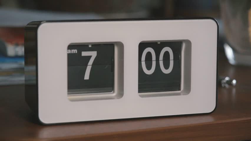 Flip clock mechanism. 7-00 AM. Super slow motion 240 fps