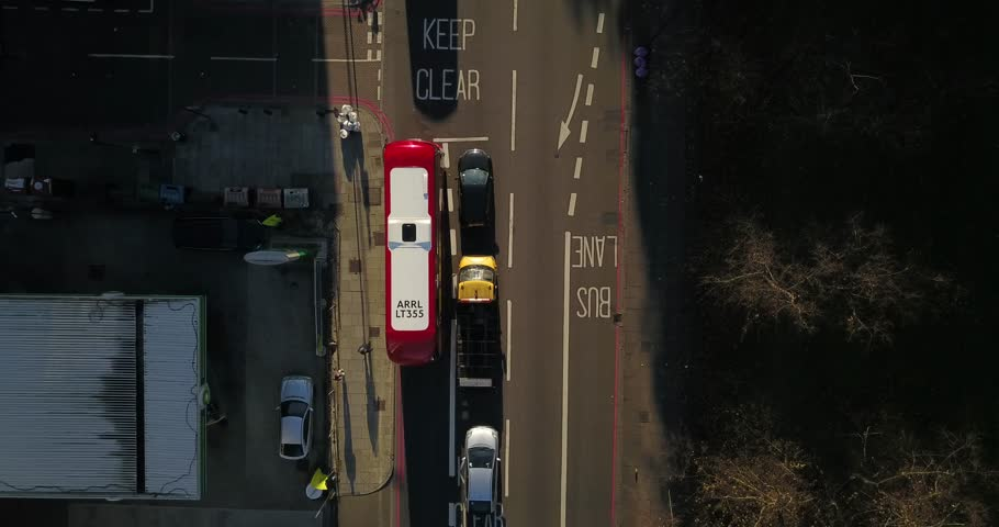November 6, 2017, London, England, United Kingdom.  Aerial Drone flight over busses and traffic on a bright sunny morning.