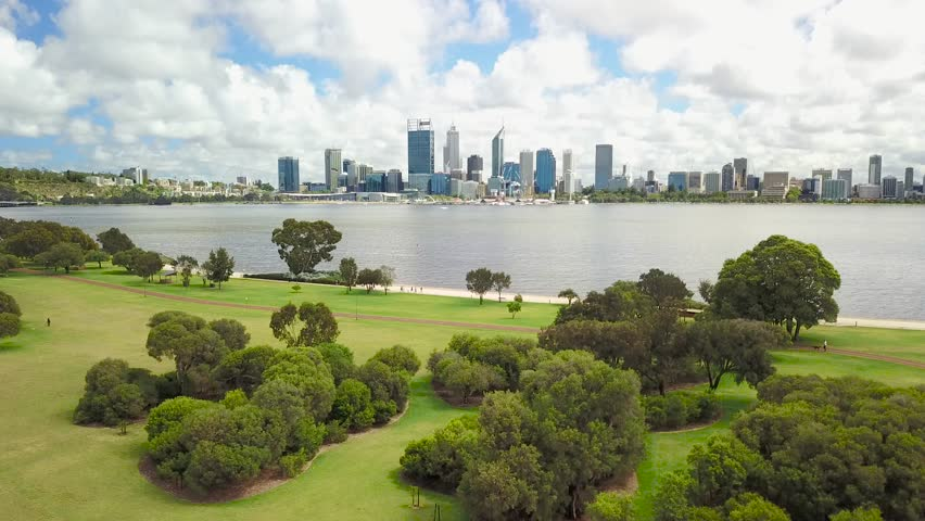 Aerial footage over Sir James Mitchell Park in South Perth with the Perth city skyline visible in the distance. Western Australia. | Shutterstock HD Video #33236428