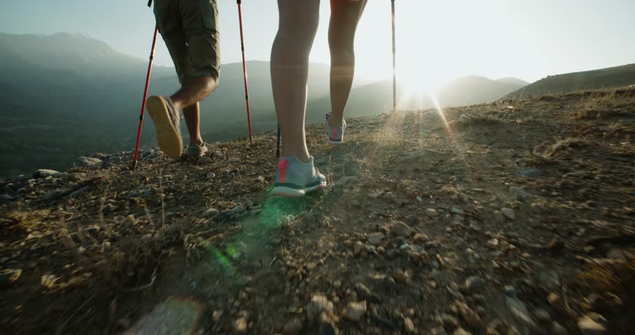 Hikers people hiking - healthy active lifestyle. Hiker people hiking in beautiful mountain nature landscape. Woman and man hikers walking during trekking hike.steadycam shot
