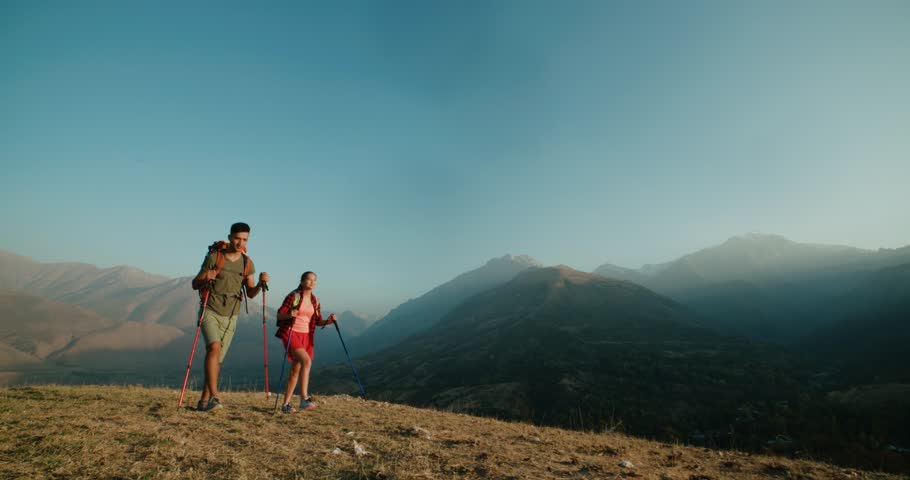 Young active Asian couple travelling in the mountains during their honeymoon, Steadicam shot | Shutterstock HD Video #33282667
