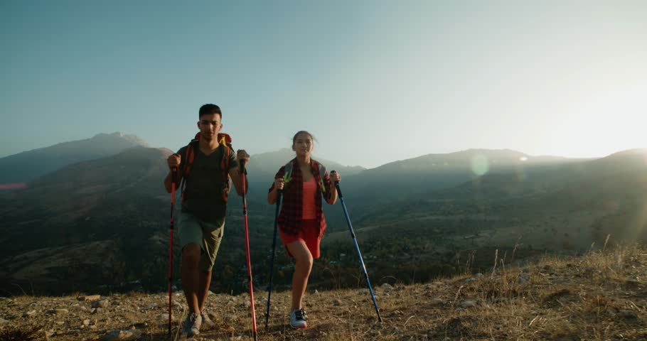 young Asian couple Hiking in the mountains on Sunny day, steadycam shot #33282679