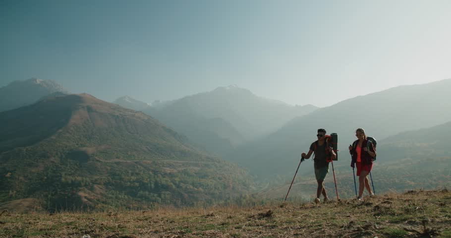 Young active Asian couple travelling in the mountains during their honeymoon, Steadicam shot   Shutterstock HD Video #33282682