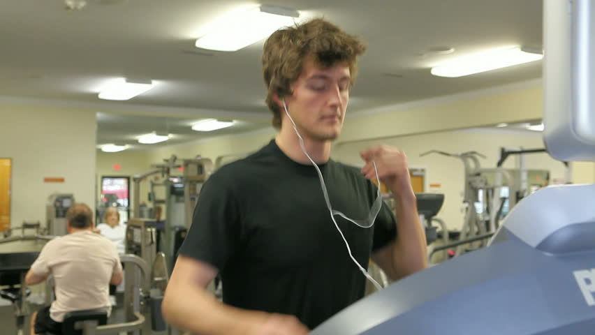 Man working out in fitness center | Shutterstock HD Video #3331508