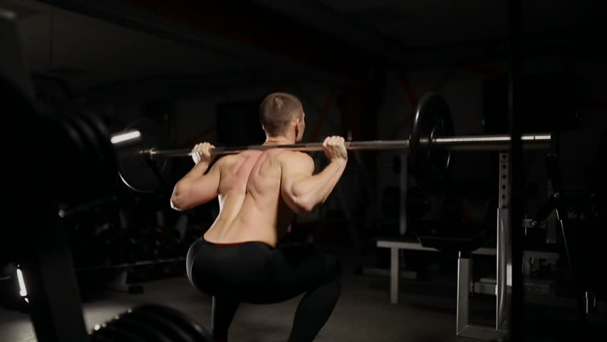 Handsome muscular man exercise squats in the gym. | Shutterstock HD Video #33321778