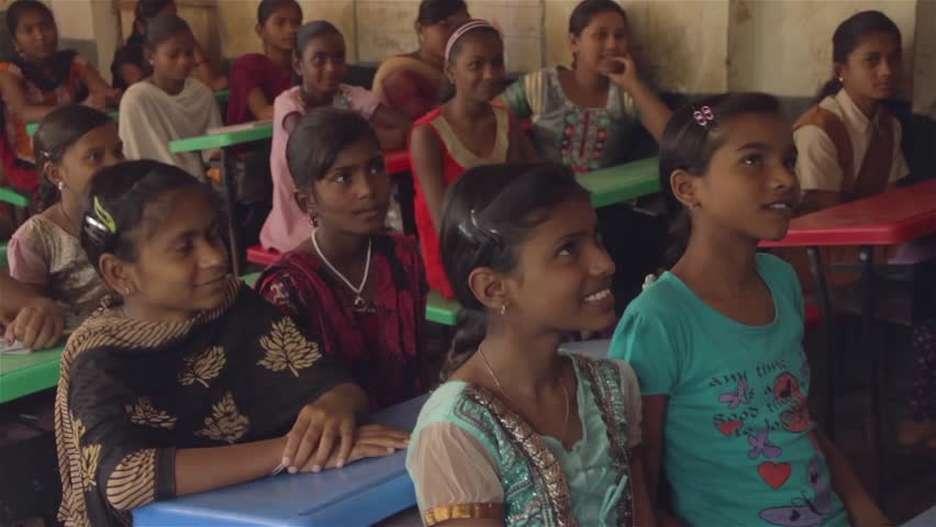 School girls sitting in a classroom are smiling and replying to a teachers questions in Chandrapur, Maharashtra, India (2017) | Shutterstock HD Video #33322426