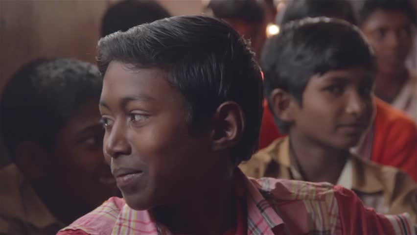 A boy from rural Indian school sitting in a classroom listening to a teacher, Chadrapur, Maharashtra, India 2017)  | Shutterstock HD Video #33324904