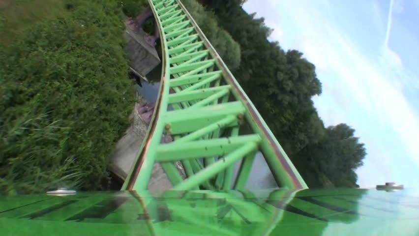 First car zipping around coaster bend