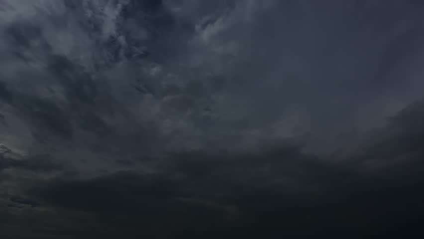 Thunderstorm clouds at night with lightning. 4K Timelapse Loop. Evening thunderstorm video landscape background. Impressive lightning storm sky. Several powerful flashes and lights.