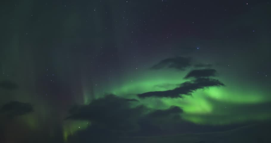 Timelapse of northern lights (Aurora borealis) at the sky