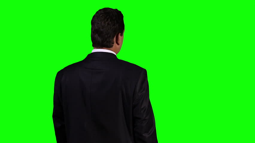 Young Businessman Back Touchscreen Greenscreen 5  Footage was shot against green screen and is keyed out. The background is pure green removing it is easy. Green spills are removed.