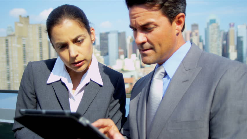 Handshake on business meeting Caucasian female and male management team using tablet computer on rooftop city office shot on RED EPIC   Shutterstock HD Video #3336269