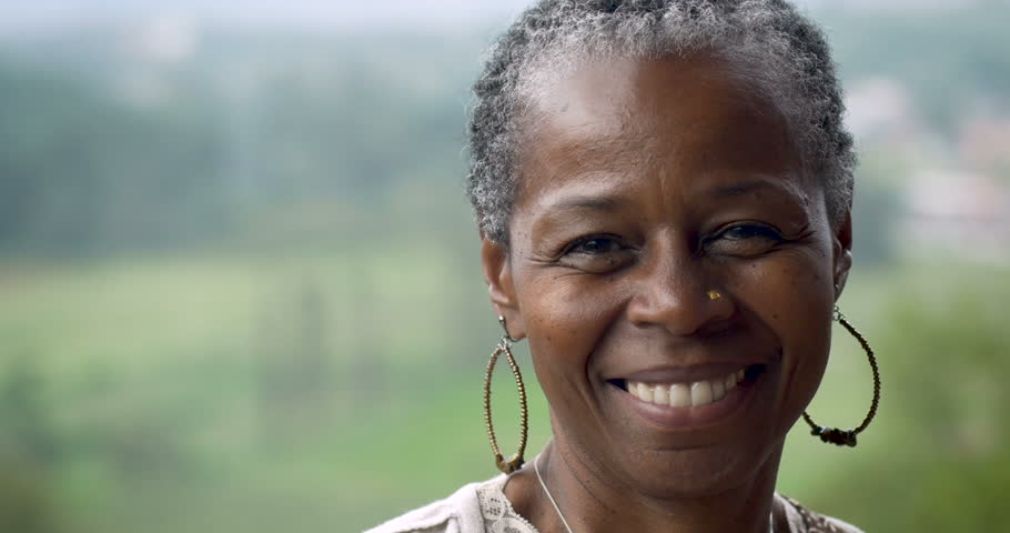 Portrait of a stunning African American woman in her 60s smiling at the camera outside | Shutterstock HD Video #33363928