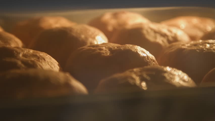Baking bread in bakery oven with high temperature at kitchen. time lapse shot