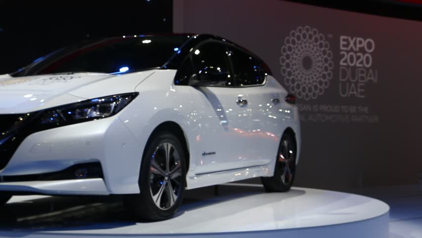 DUBAI, UAE - November 14: Nissan Leaf 2018 electric zero emission car unveiling ceremony during Dubai Int'l Motor Show 2017 at Dubai Int'l Convention and Exhibition Centre.   Shutterstock HD Video #33405931
