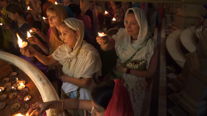 Vrindavan - 10.10.2017: Many people participate in Hare Krishna Kartik light offering ceremony in Vrindavan ISKCON temple   Shutterstock HD Video #33406876